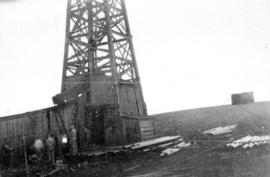 Oil country - [Men at oil well in Turner Valley, Alberta]