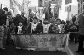 Children carrying a banner in a parade on Pender Street in Vancouver Chinatown