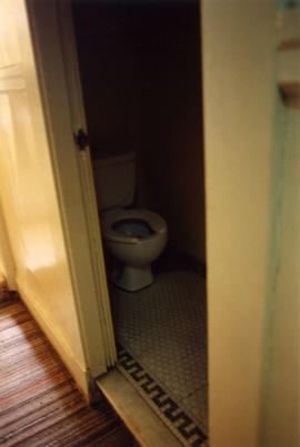 Water closet inside Columbia Hotel at 303 Columbia Street