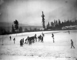 Boys playing rugby on snow covered field at Brockton Point