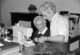 Knox United quilters, Marie Monro (standing)