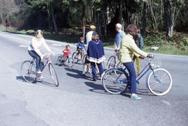 Family riding bicycles in Stanley Park