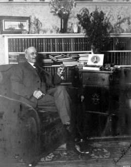 Louis D. Taylor in his office