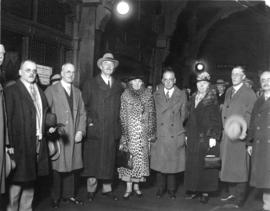 [Group portrait showing Mayor L.D. Taylor with Viscount and Lady Allenby inside the C.P.R. Station]