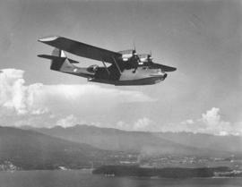 "[PBY aircraft ""Athlone"" flying over Vancouver]"