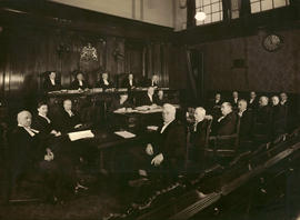 [Members and clerks of the Provincial Supreme Court, in chamber]