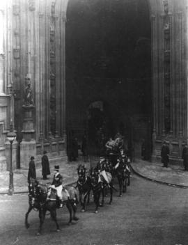 [ King George and Queen Mary leave the Houses of Parliament in a carriage after reading the Speec...