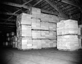 [Crates of salmon and other goods in the Evans, Coleman, and Evans, Ltd. warehouse]