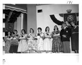 Miss P.N.E. 1956 contestants on Outdoor Theatre stage, P.N.E. President W.J. Borrie to left