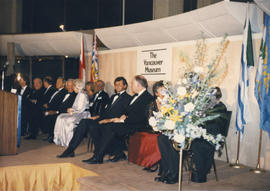 Officials seated on stage at the Remembering Vancouver display opening at the Museum of Vancouver