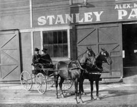 Dr. C. N. Henderson and Alex Mitchell in front of Stanley Park Stables