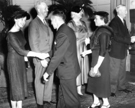 Sherwood Lett and Mrs. Evelyn Lett passing through a receiving line