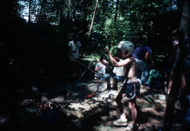 Children near campfire - in shadows of trees