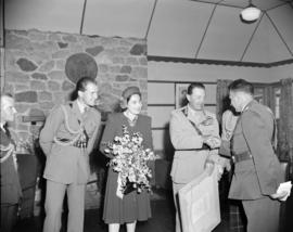 [Lord Alexander and his party greeting military officials at the RCE hall]