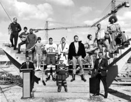 Athletes and performers representing future uses of the Pacific Coliseum standing in the construc...