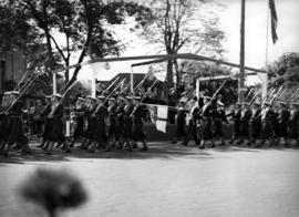 [King George VI and Queen Elizabeth reviewing naval parade on Douglas Street]