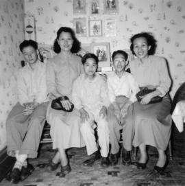 Gum May Yee, Mrs. Chan, Guy Yee, and two of Mrs. Chan's sons