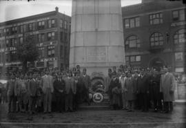 "Ceremony at the Cenotaph at Victory Square, men wearing hats with the text ""Aladdin"""