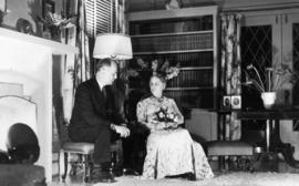 W.O. Banfield and Harriet Banfield in living room of 5575 Angus Avenue
