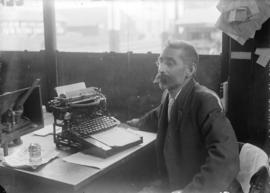 [J.H. Field seated with caligraph typewriter at Alexander Street branch of C.P.R. telegraph office]