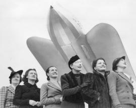 "[Six of the ""Flying Seven"" in front of a rocket]"