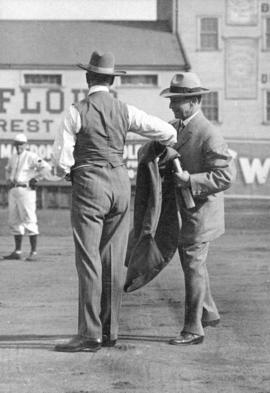 [Mayor L.D. Taylor prepares to throw baseball at opening of baseball season]