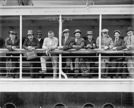 Group of boxers going to Australia [at ship's railing]