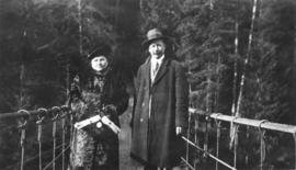 [L.D. Taylor and unidentified woman standing on Capilano Suspension Bridge]