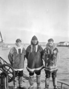 [Captain W.G. Gillen of the St. Roch with his sons Ivor and Rupert dressed in fur and mukluks]