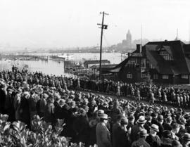 [Crowds line the road in front of the Vancouver Rowing Club to watch the Naval and Military parad...