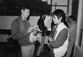 Writers Goh Poh Seng and SKY Lee at the Saltwater City exhibit reading at the Chinese Cultural Ce...