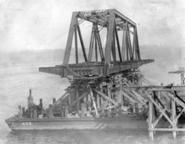 Second Narrows Bridge, 6th March 1925. Shewing [sic] steel span on scows just prior to being floa...