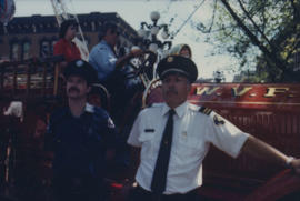 Two members of the Fire Department next to fire engine