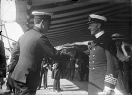 "Officers shaking hands on H.M.S. ""New Zealand"""