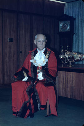 W.O. B[anfield] in mayor's robes seated