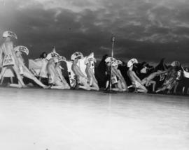 [Men dressed in First Nations' patterned costumes during a performance at lower Brockton Point fo...