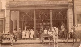 [Group portrait in front of Hayes and McIntosh butchers - 36 Cordova Street]