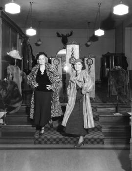 Stevens sisters [modelling fur coats at the] New York Fur Company [797 West Georgia Street]