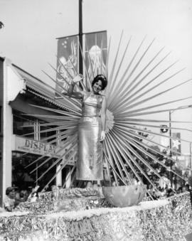 Woman on unidentified float in P.N.E. Opening Day Parade