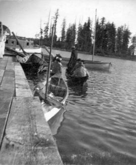 [Unidentified people in canoes]