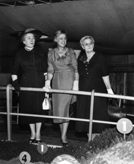 Three unidentified ladies at exhibit on P.N.E. grounds
