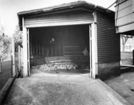 [The interior of a six-sided structure (garage) beside a house]