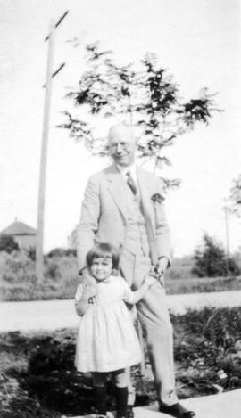 [L.D. Taylor standing outside with small girl]