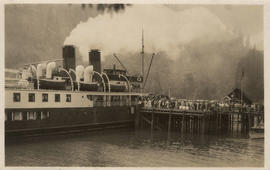 [Steamship loading at dock]