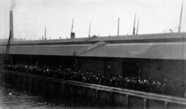 [Unidentified dock filled with people]