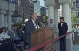 Unidentified man speaking at Portal Park opening