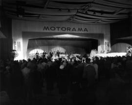 Crowd watching stage performance in Motorama car show, Pacific Showmart building