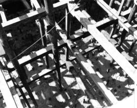 Looking down into the cofferdam [bridge support construction (detail)]