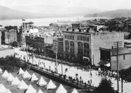 [View of Dominion Day military parade on] Granville Street [from the Hotel Vancouver]