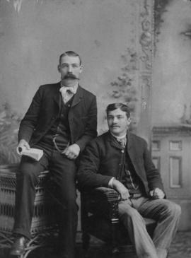[Studio portrait of Frank Bennett and C. Miller]